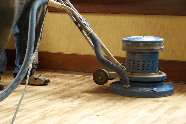 An image of a floor sander being used