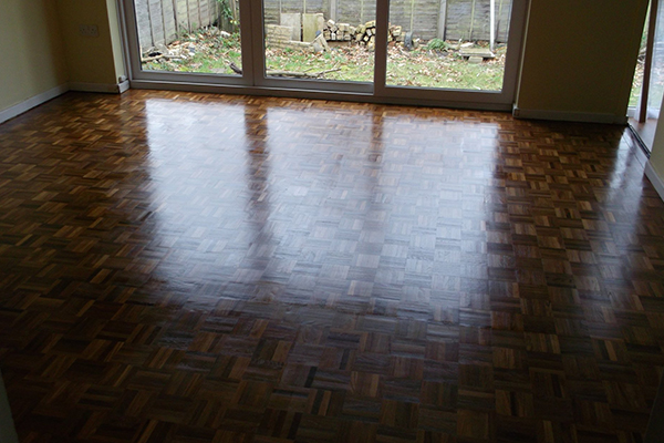 An image of a room with a feashly polished floor