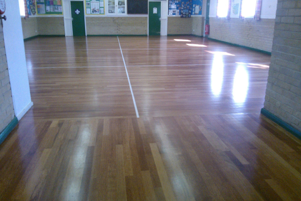 An image of a community center with a newly polished floor